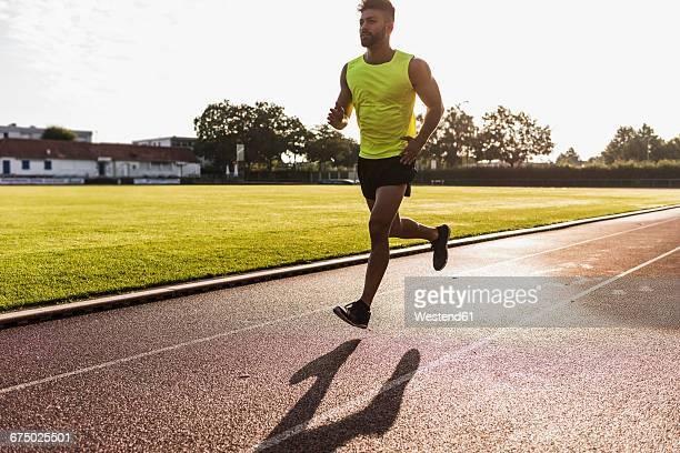 Athlete running on tartan track