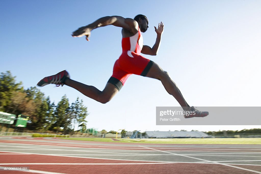 Athlete running on track, side view : Foto stock