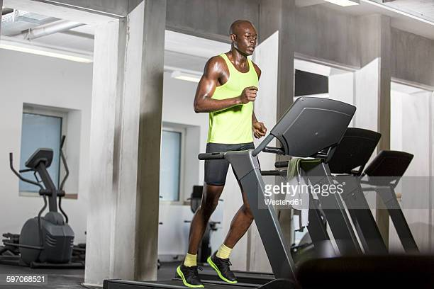Athlete running on treadmill in gym