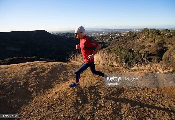 Athlete runs in hills overlooking Los Angeles