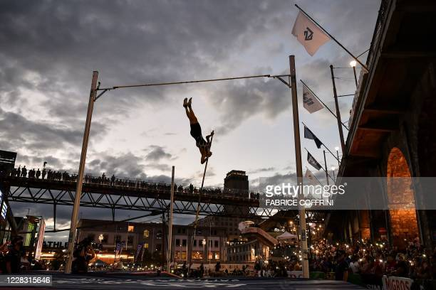 Athlete Sam Kendricks performs as he takes part in a men's pole vaulting exhibition street event of the Diamond League athletics meeting Athletissima...