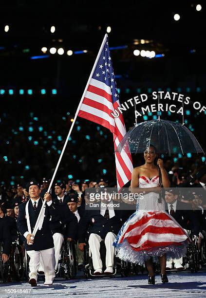 Athlete Scott Danberg of United States carries the flag during the Opening Ceremony of the London 2012 Paralympics at the Olympic Stadium on August...