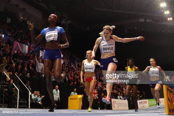 US athlete Shakima Wimbley and Britain's Eilidh Doyle compete in the women's 400m final at the 2018 IAAF World Indoor Athletics Championships at the...