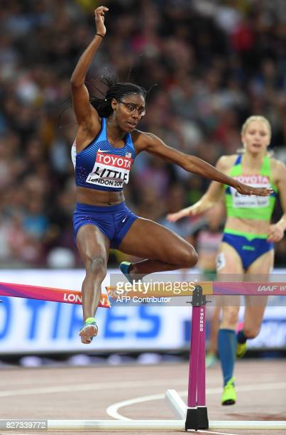 US athlete Shamier Little breaks a hurdle on her way to qualifying in the heats of the women's 400m hurdles athletics event at the 2017 IAAF World...