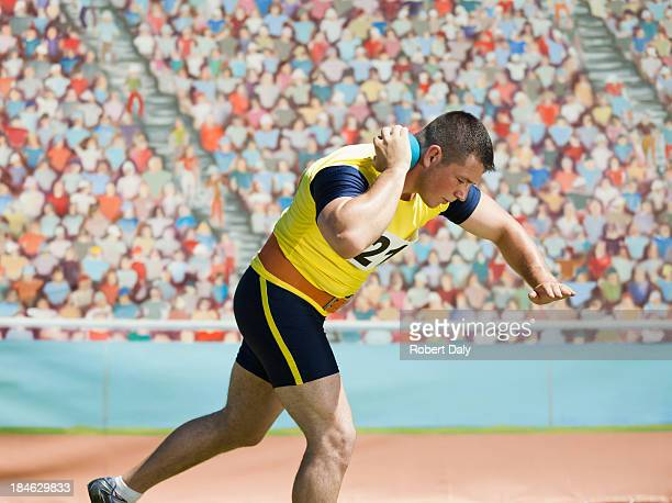 athlete shot putting in an arena - men's field event stock pictures, royalty-free photos & images