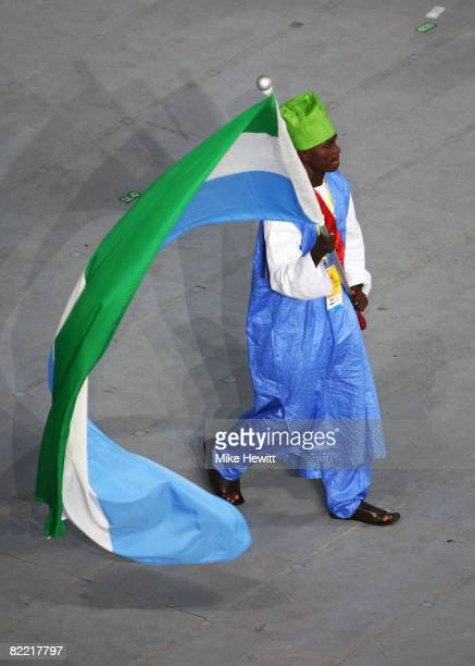 Athlete Solomon Bayoh of Sierra Leone carries his country's flag during during the Opening Ceremony for the 2008 Beijing Summer Olympics at the...