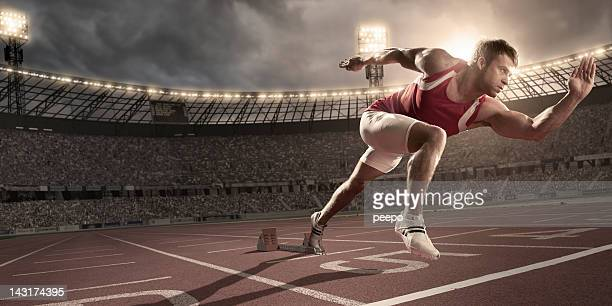 Athlete Sprinting From Blocks