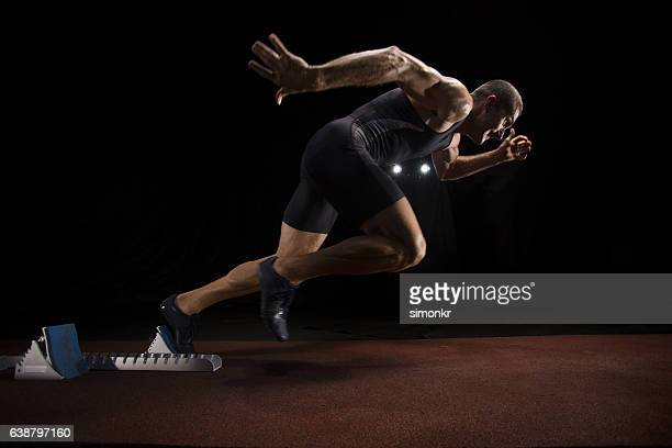 athlete sprinting on track - sprinting stock pictures, royalty-free photos & images
