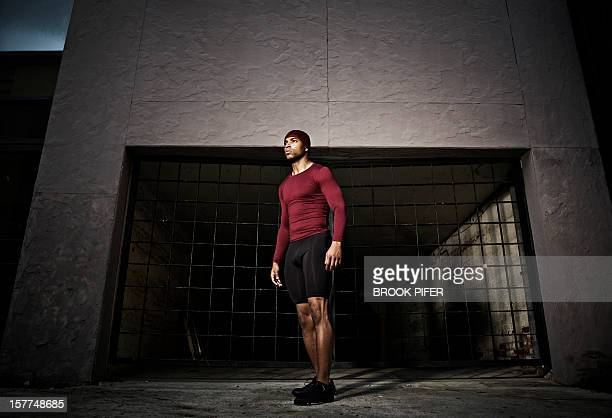 Athlete standing in alley