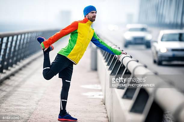 Athlete stretching leg on the bridge