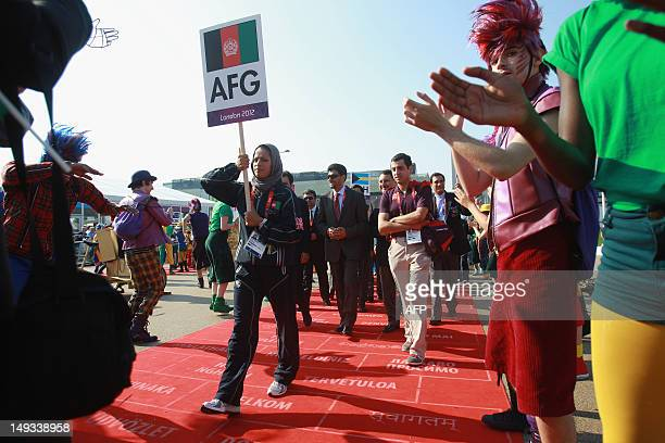 Athlete Tahmina Kohistani of Afghanistan leads the team during the Olympic Village arrivals ahead of the London 2012 Olympic Games at the Olympic...