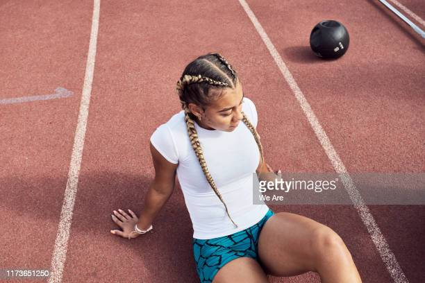 athlete taking a break from training - resting stock pictures, royalty-free photos & images