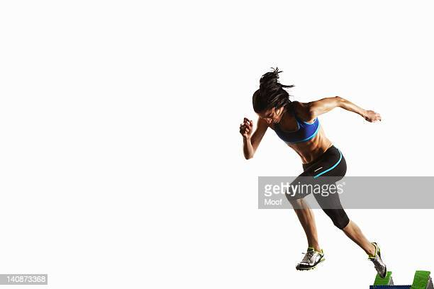 Athlete taking off from starting block