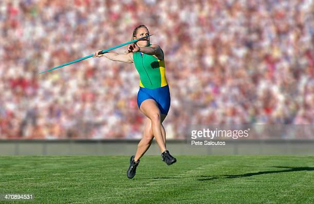 athlete throwing javelin - やり投げ ストックフォトと画像