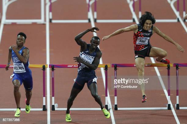 US athlete TJ Holmes France's Mamadou Kasse Hann and Japan's Takatoshi Abe compete in the semifinal of the men's 400m hurdles athletics event at the...
