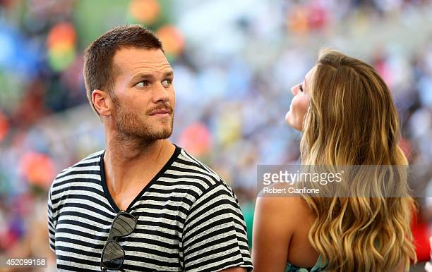 NFL athlete Tom Brady and model Gisele Bundchen look on prior to the 2014 FIFA World Cup Brazil Final match between Germany and Argentina at Maracana...