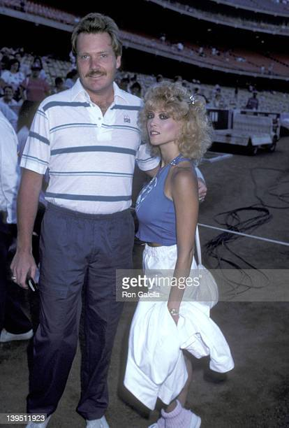 Athlete Tom Niedenfuer and actress Judy Landers attend the 28th Annual Hollywood Stars Night Celebrity Baseball Game on August 23 1986 at Dodger...