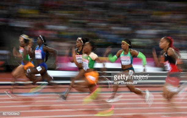 TOPSHOT US athlete Tori Bowie runs to gold in the final of the women's 100m athletics event at the 2017 IAAF World Championships at the London...