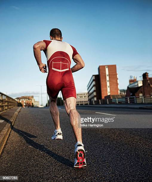 athlete training for triathlon - shorts stock pictures, royalty-free photos & images