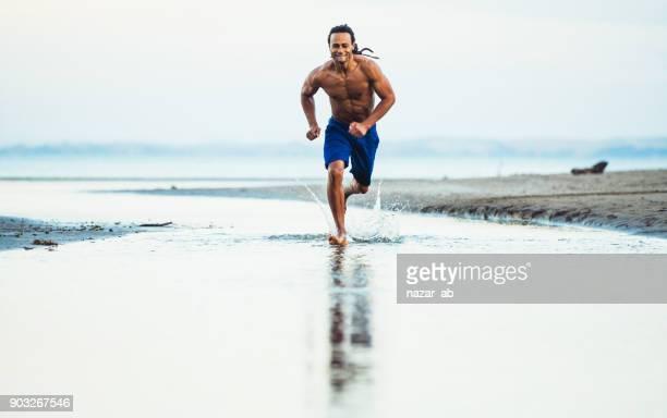 Athlete training outdoor on beach.
