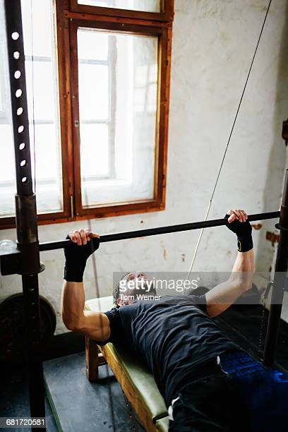 Athlete training with bench press
