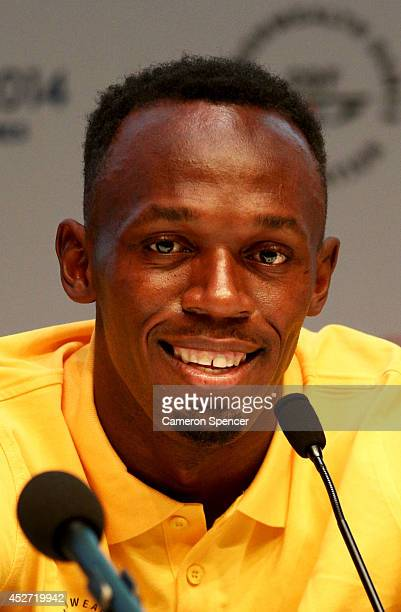 Athlete Usain Bolt of Jamaica attends a press conference and photocall at the Main Press Centre during day three of the Glasgow 2014 Commonwealth...