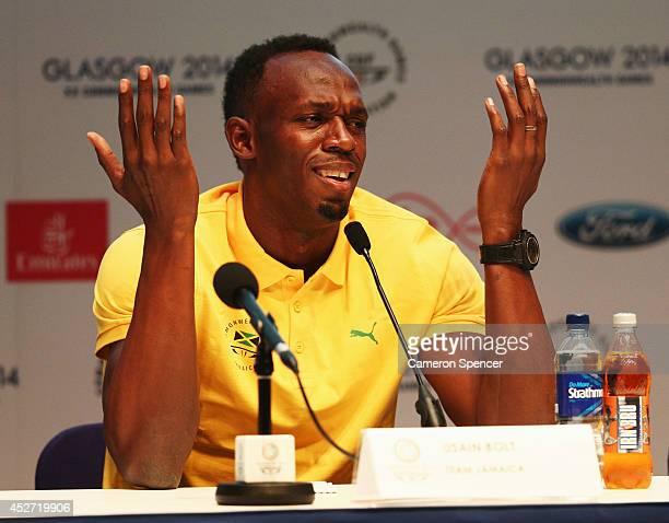 Athlete Usain Bolt of Jamaica reacts to a question as he attends a press conference and photocall at the Main Press Centre during day three of the...