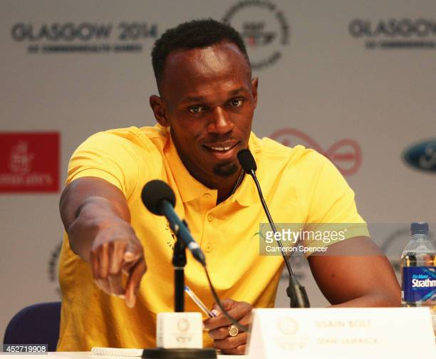 Athlete Usain Bolt of Jamaica responds to a question as he attends a press conference and photocall at the Main Press Centre during day three of the...