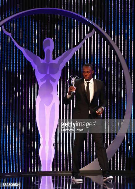Athlete Usain Bolt of Jamaica with his Laureus World Sportsman of the Year Award on stage during the 2017 Laureus World Sports Awards at the Salle...