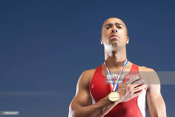 Athlete wearing medal outdoors