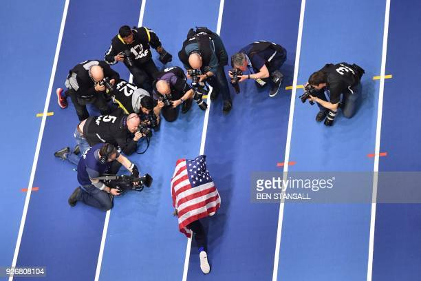 TOPSHOT US athlete Will Claye celebrates taking gold in the men's triple jump final at the 2018 IAAF World Indoor Athletics Championships at the...