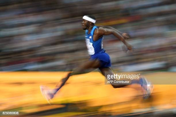 US athlete Will Claye competes in the final of the men's triple jump athletics event at the 2017 IAAF World Championships at the London Stadium in...