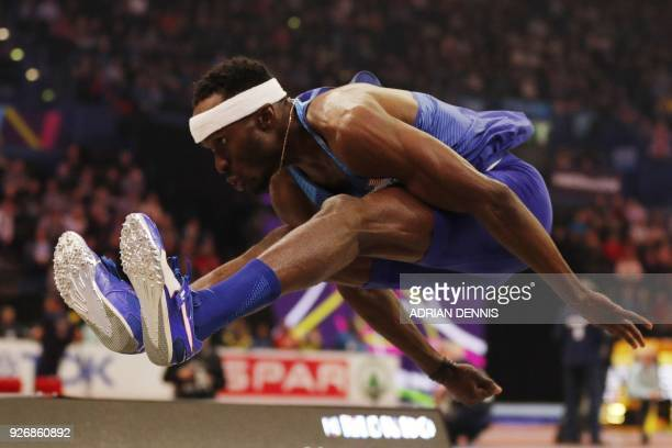 TOPSHOT US athlete Will Claye competes in the men's triple jump final at the 2018 IAAF World Indoor Athletics Championships at the Arena in...