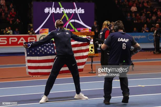 TOPSHOT US athlete Will Claye reacts after winning the men's triple jump final at the 2018 IAAF World Indoor Athletics Championships at the Arena in...