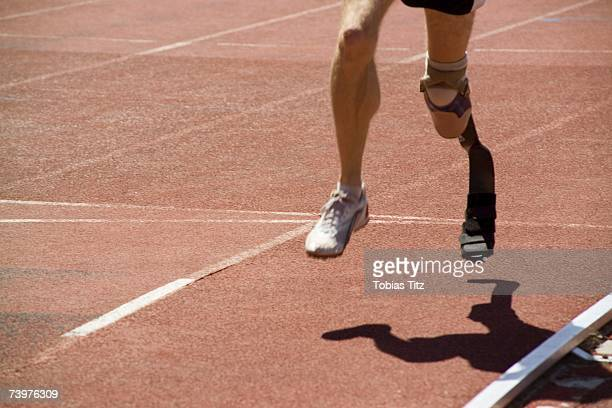 Athlete with a prosthetic leg running on a track