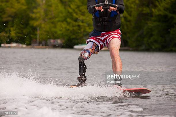 Athlete with an artificial leg waterskiing