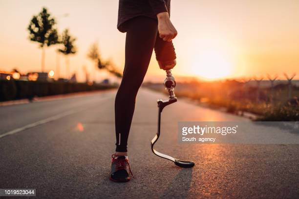 athlete with artificial limb - artificial limb stock photos and pictures