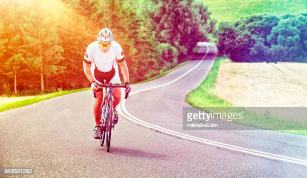Athlete with determination rides professional race bike on a hill