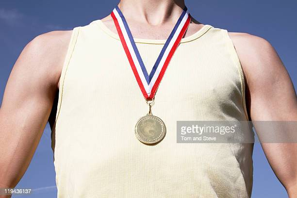. athlete with gold medal - medalist stock pictures, royalty-free photos & images
