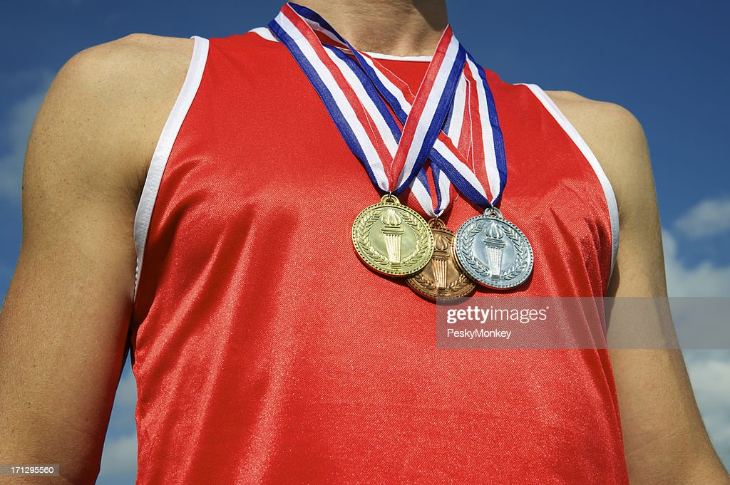 Athlete with Gold Silver Bronze Medals Bright Blue Sky : Stock Photo