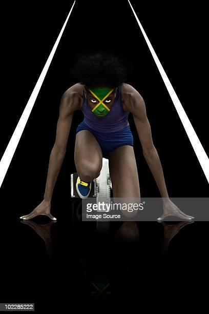 Sportler mit Jamaikanische Flagge Gesicht Farbe