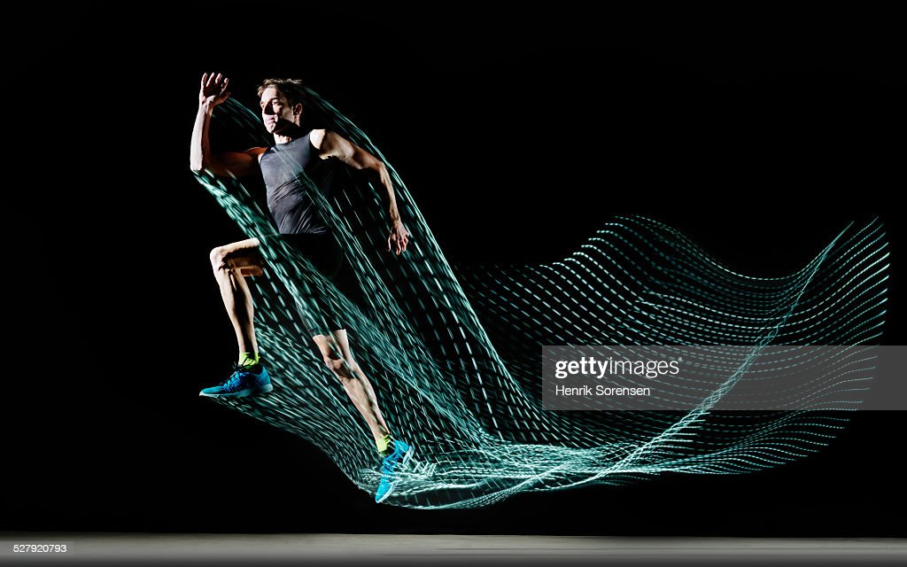 athlete with lighttrace : Stock Photo