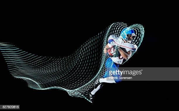 athlete with lighttrace - rush american football stock pictures, royalty-free photos & images