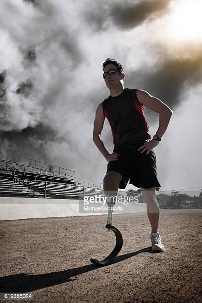 Athlete With Prosthetic Leg In Race Starting Postion