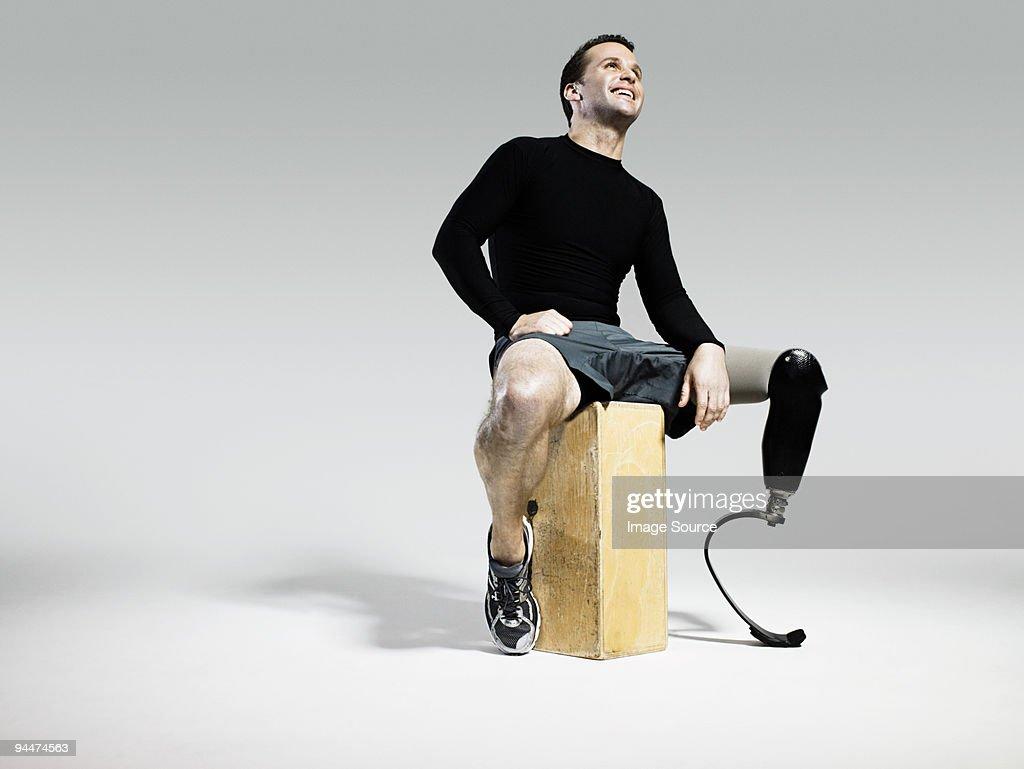 Athlete with prosthetic leg : Stock Photo