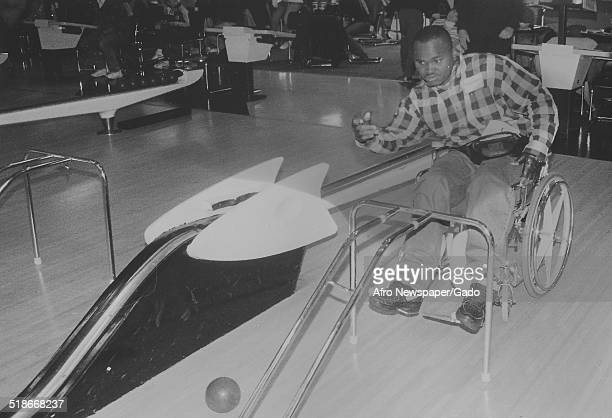 Athlete, with wheelchair, bowling during the Special Olympics, Maryland, February 11, 1995.