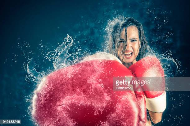 Athlete woman fighting boxing with gloves