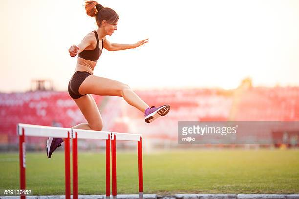 Athlete woman hurdling