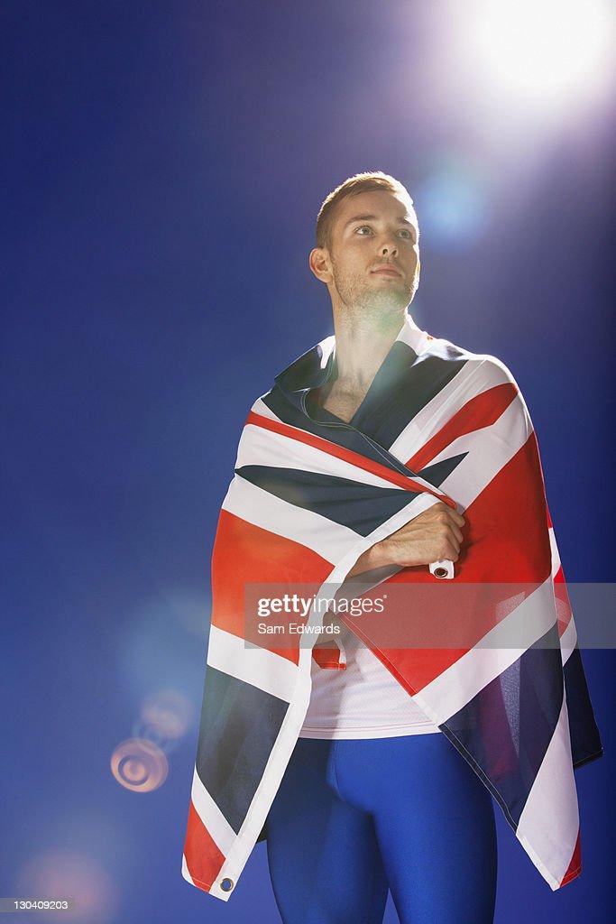 Athlete wrapped in Union Jack flag : Stock Photo