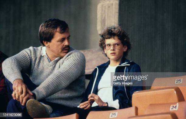 Athlete Zola Budd chats with coach Peter Labaschagne during a Track meeting circa 1985 in London, United Kingdom.